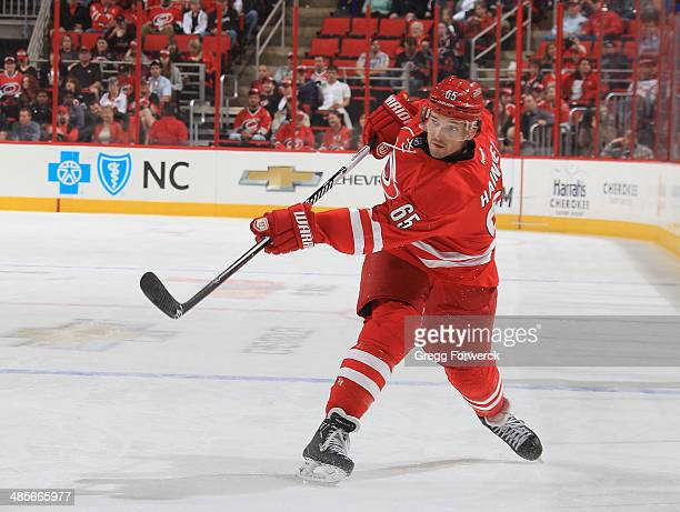 Ron Hainsey of the Carolina Hurricanes takes a shot on goal during their NHL game against the Washington Capitals at PNC Arena on April 10 2014 in...