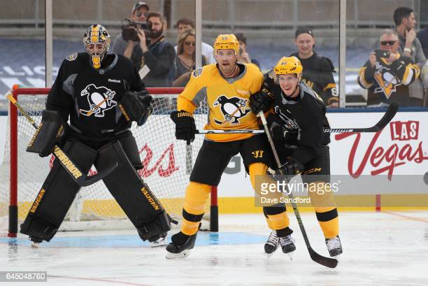 Ron Hainsey of the Pittsburgh Penguins and Sidney Crosby of the Pittsburgh Penguins vie for position in front of the net during practice for the 2017...