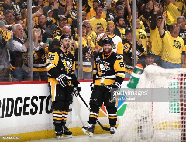 Ron Hainsey of the Pittsburgh Penguins celebrates his goal with teammate Phil Kessel during the second period of Game Five of the 2017 NHL Stanley...