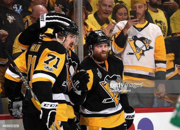 Ron Hainsey of the Pittsburgh Penguins celebrates his goal with teammate Phil Kessel and Evgeni Malkin during the second period of Game Five of the...