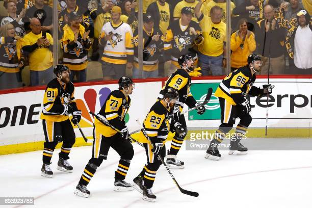 Ron Hainsey of the Pittsburgh Penguins celebrates with Evgeni Malkin Phil Kessel Scott Wilson and Brian Dumoulin after scoring his team's sixth goal...