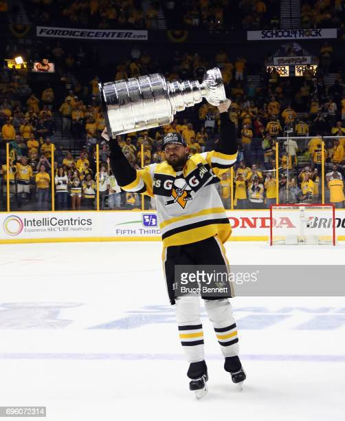 Ron Hainsey of the Pittsburgh Penguins celebrates with the Stanley Cup following a victory over the Nashville Predators in Game Six of the 2017 NHL...