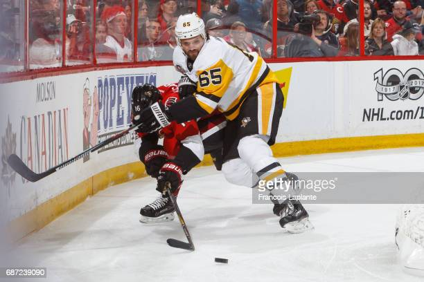 Ron Hainsey of the Pittsburgh Penguins controls the puck against Clarke MacArthur of the Ottawa Senators in Game Four of the Eastern Conference Final...