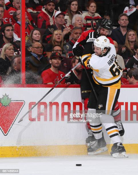 Ron Hainsey of the Pittsburgh Penguins hits Clarke MacArthur of the Ottawa Senators into the boards in Game Six of the Eastern Conference Final...