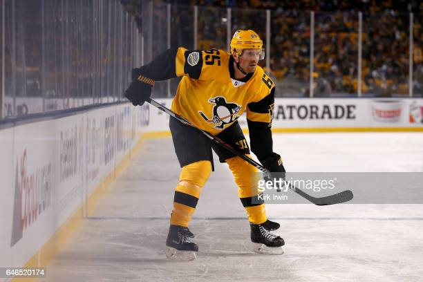 Ron Hainsey of the Pittsburgh Penguins lines up for a faceoff during the game against the Philadelphia Flyers at Heinz Field on February 25 2017 in...