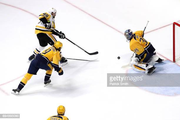 Ron Hainsey of the Pittsburgh Penguins puts a shot on goal defended by Pekka Rinne and Filip Forsberg of the Nashville Predators during the second...