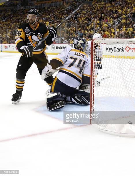 Ron Hainsey of the Pittsburgh Penguins scores his team's sixth goal against Juuse Saros of the Nashville Predators in the second period in Game Five...