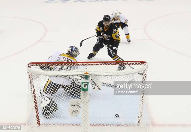 Ron Hainsey of the Pittsburgh Penguins scores on Juuse Saros of the Nashville Predators in Game Five of the 2017 NHL Stanley Cup Final at the PPG...