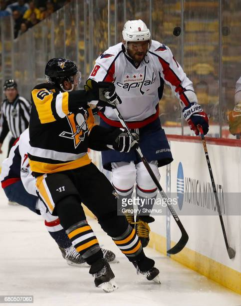 Ron Hainsey of the Pittsburgh Penguins skates against TJ Oshie and Alex Ovechkin of the Washington Capitals in Game Six of the Eastern Conference...