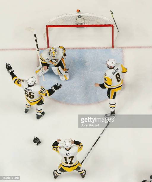 Ron Hainsey of the Pittsburgh Penguins skates toward Matt Murray of the Pittsburgh Penguins along with Bryan Rust and Brian Dumoulin following Game...