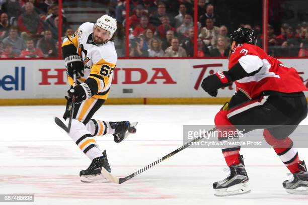 Ron Hainsey of the Pittsburgh Penguins takes a shot against Marc Methot of the Ottawa Senators during the first period in Game Six of the Eastern...