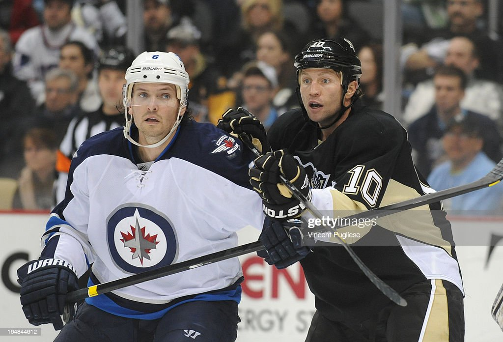Ron Hainsey #6 of the Winnipeg Jets and Brenden Morrow #10 of the Pittsburgh Penguins battle for position during the third period on February 28, 2013 at the CONSOL Energy Center in Pittsburgh, Pennsylvania.