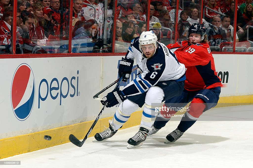 <a gi-track='captionPersonalityLinkClicked' href=/galleries/search?phrase=Ron+Hainsey&family=editorial&specificpeople=206345 ng-click='$event.stopPropagation()'>Ron Hainsey</a> #6 of the Winnipeg Jets battles for the puck against Nicklas Backstrom #19 of the Washington Capitals during a game at Verizon Center on January 22, 2013 in Washington, DC.