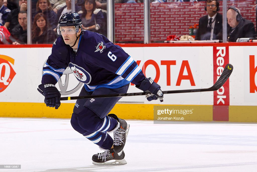 <a gi-track='captionPersonalityLinkClicked' href=/galleries/search?phrase=Ron+Hainsey&family=editorial&specificpeople=206345 ng-click='$event.stopPropagation()'>Ron Hainsey</a> #6 of the Winnipeg Jets follows the play up the ice during the third period against the Florida Panthers at the MTS Centre on April 11, 2013 in Winnipeg, Manitoba, Canada. The Jets defeated the Panthers 7-2.