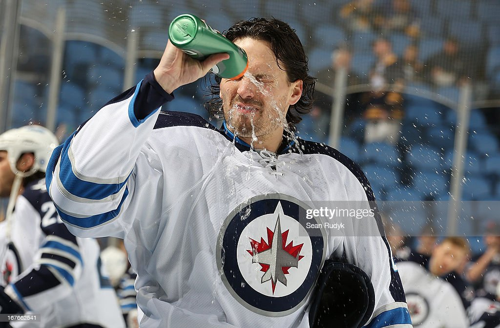 Ron Hainsey #6 of the Winnipeg Jets takes a water break before skating against the Buffalo Sabres at First Niagara Center on April 22, 2013 in Buffalo, New York.