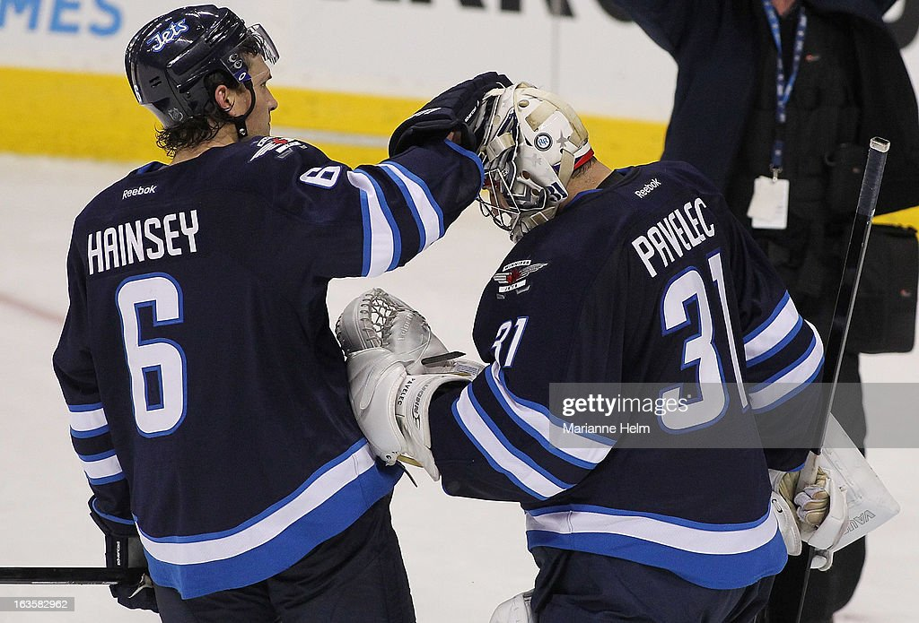<a gi-track='captionPersonalityLinkClicked' href=/galleries/search?phrase=Ron+Hainsey&family=editorial&specificpeople=206345 ng-click='$event.stopPropagation()'>Ron Hainsey</a> #6 of the Winnipeg Jets taps Ondrej Pavelec #31 on the head after they defeated the Toronto Maple Leafs 5-2 on March 12, 2013 at the MTS Centre in Winnipeg, Manitoba, Canada.