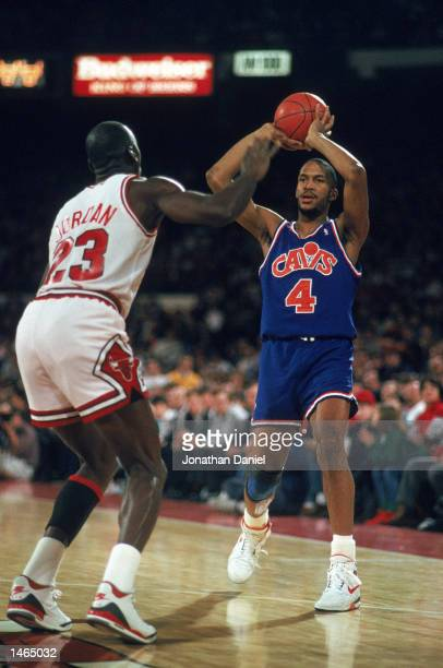 Ron Harper of the Cleveland Cavaliers holds the ball as Michael Jordan plays defense in Chicago Illinois during the 19881989 NBA season Mandatory...