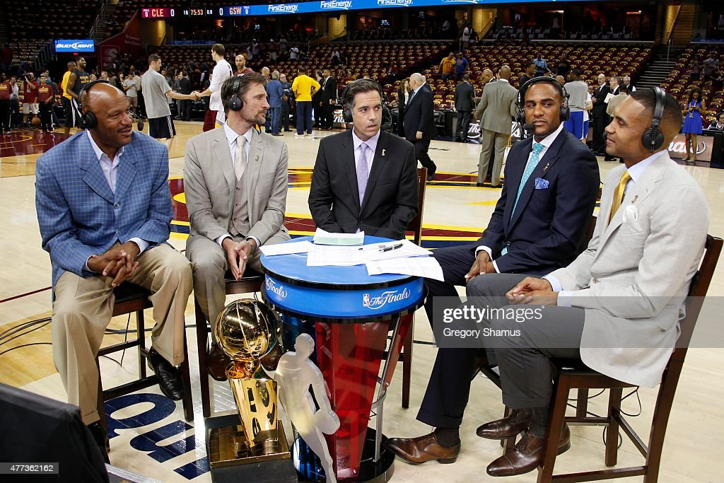 Ron Harper speaks to NBA TV's Brent Barry, Matt Winer, Steve Smith and Grant Hill before Game Six of the 2015 NBA Finals between Golden State Warriors and the Cleveland Cavaliers at the Quicken Loans Arena on June 16, 2015 in Cleveland, Ohio