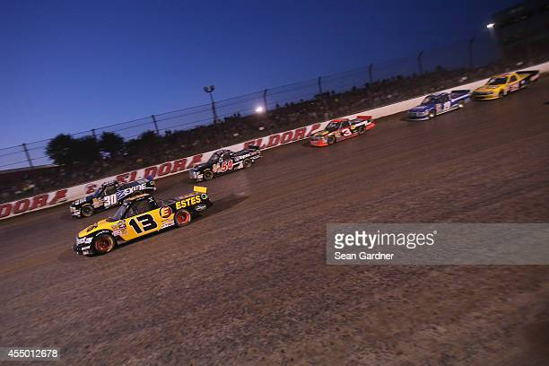 Ron Hornaday Jr driver of the Exide Chevrolet races with Jeb Burton driver of the EstesCarolina Nut Company Toyota during the NASCAR Camping World...