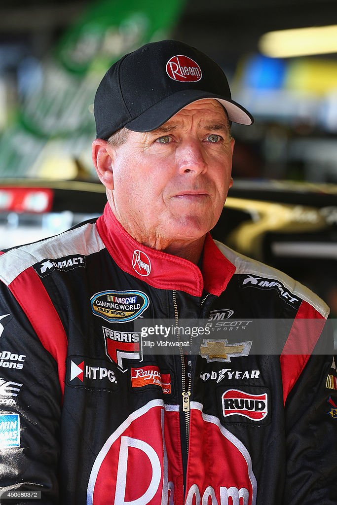 Ron Hornaday Jr, driver of the #30 Rheem Chevrolet waits in the garage during practice for the NASCAR Camping World Truck Series Drivin' for Linemen 200 at Gateway Motorsports Park on June 13, 2014 in Madison, Illinois.