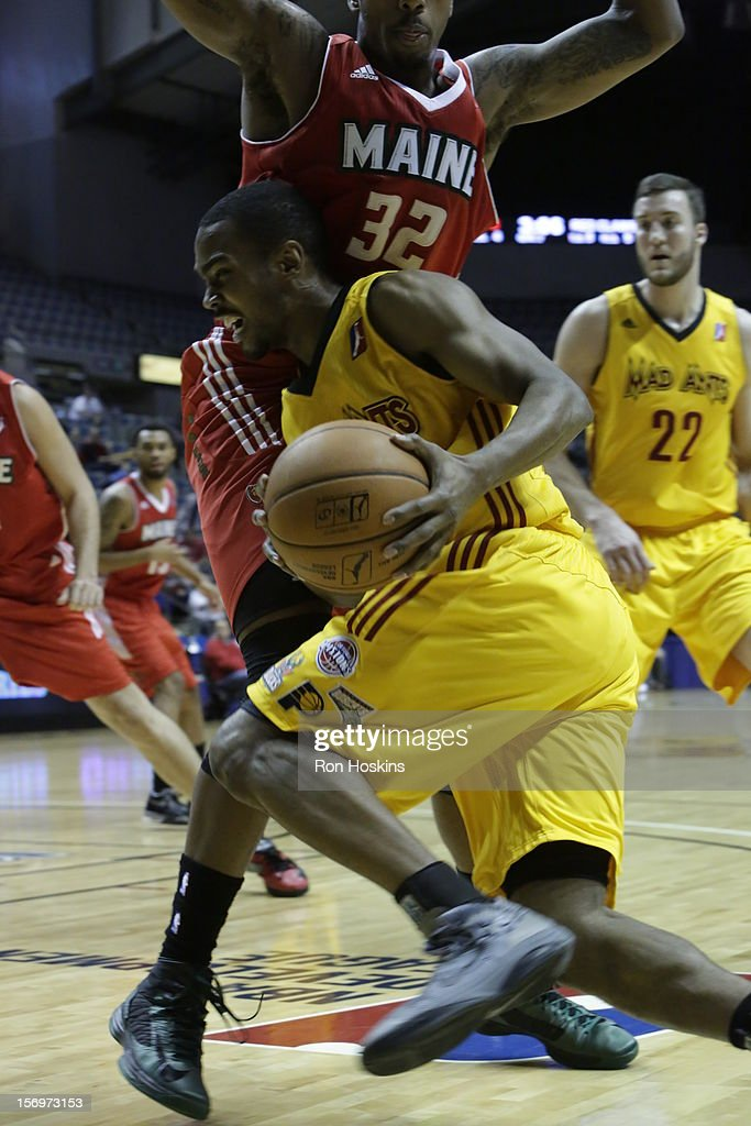 Ron Howard #18 of the Fort Wayne Mad Ants drives on Kris Joseph #32 of the Maine Red Claws at Allen County Memorial Coliseum on November 25, 2010 in Fort Wayne, Indiana.