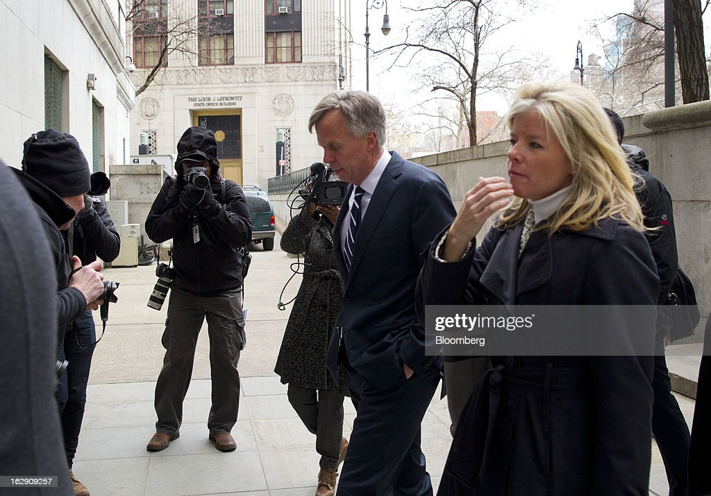 Ron Johnson, chief executive officer of J.C. Penney Co., center, arrives at State Supreme court in New York, U.S., on Friday, March 1, 2013. Johnson took the witness stand to testify in a dispute between his department-store chain and Macy's Inc. over the right to sell Martha Stewart Living Omnimedia Inc. merchandise. Photographer: Jin Lee/Bloomberg via Getty Images
