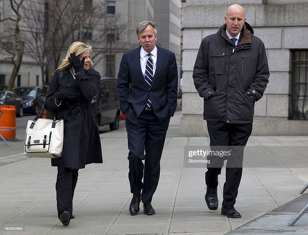 Ron Johnson, chief executive officer of J.C. Penney Co., center, exits State Supreme court in New York, U.S., on Friday, March 1, 2013. Johnson took the witness stand to testify in a dispute between his department-store chain and Macy's Inc. over the right to sell Martha Stewart Living Omnimedia Inc. merchandise. Photographer: Jin Lee/Bloomberg via Getty Images