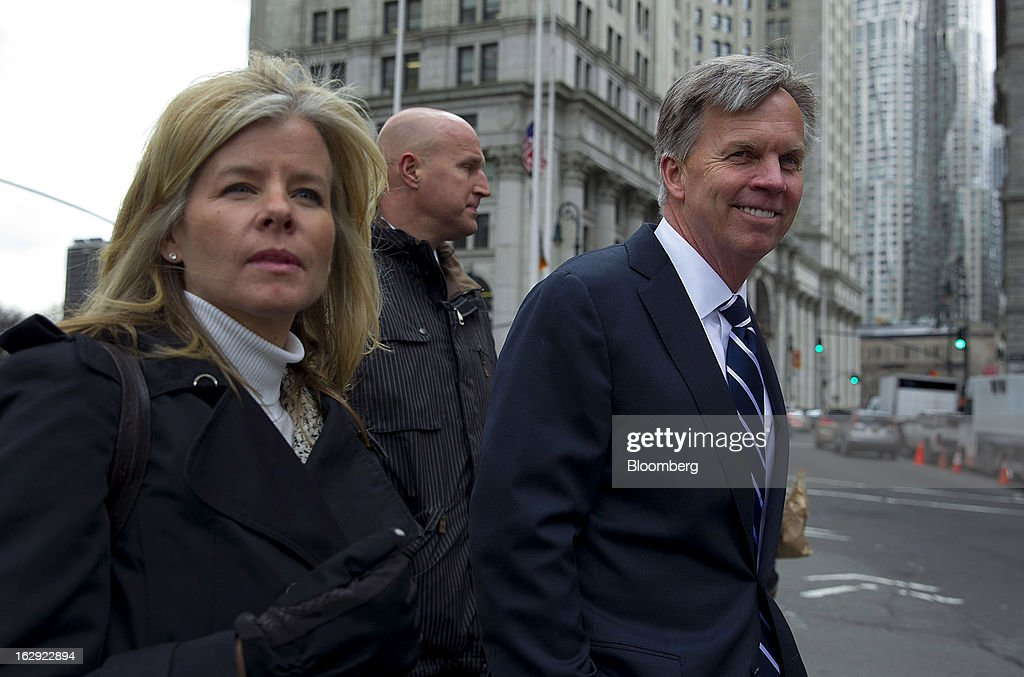 Ron Johnson, chief executive officer of J.C. Penney Co., right, exits State Supreme court in New York, U.S., on Friday, March 1, 2013. Johnson took the witness stand to testify in a dispute between his department-store chain and Macy's Inc. over the right to sell Martha Stewart Living Omnimedia Inc. merchandise. Photographer: Jin Lee/Bloomberg via Getty Images