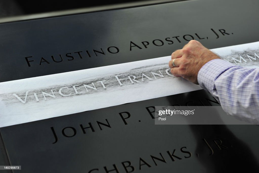 Ron Joy makes a rubbing of his friend's name, New York Fire Department firefighter Capt. Vincent Giammona, at the South reflecting pool of the 9/11 Memorial during ceremonies for the twelfth anniversary of the terrorist attacks on lower Manhattan at the World Trade Center site on September 11, 2013 in New York City. The nation is commemorating the anniversary of the 2001 attacks which resulted in the deaths of nearly 3,000 people after two hijacked planes crashed into the World Trade Center, one into the Pentagon in Arlington, Virginia and one crash landed in Shanksville, Pennsylvania. Following the attacks in New York, the former location of the Twin Towers has been turned into the National September 11 Memorial & Museum.