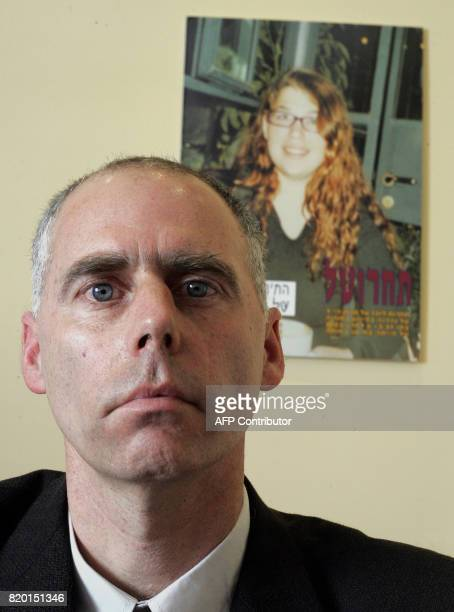 Ron Kehermann one of three fathers whose sons were killed in a suicide bus explosion sits in front of a picture of daughter Tal during a press...