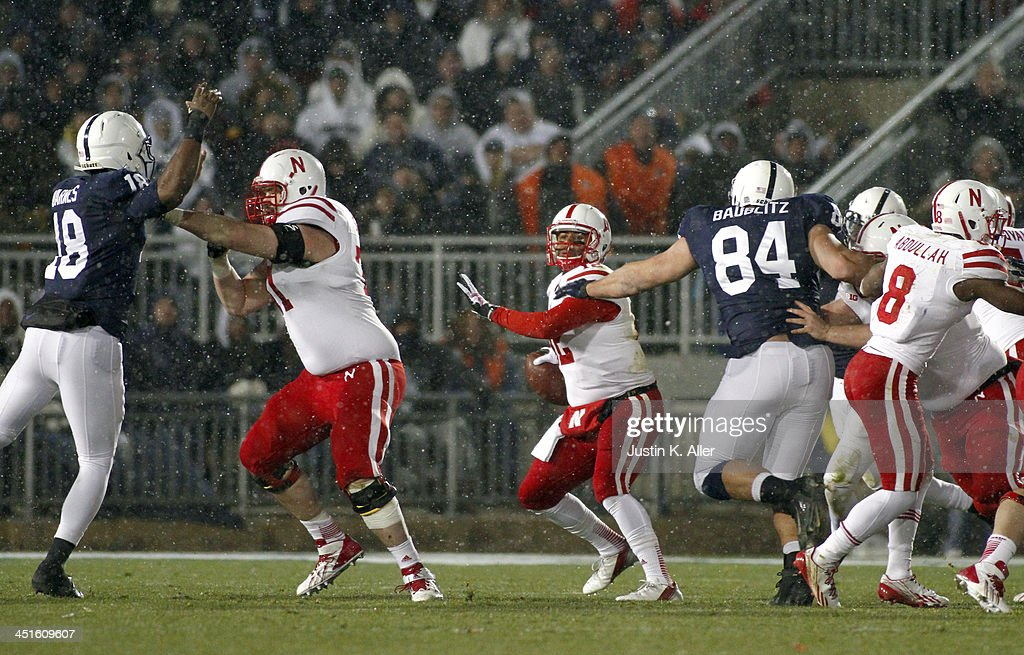 Ron Kellogg III #12 of the Nebraska Cornhuskers is pressured by the Penn State Nittany Lions during the game on November 23, 2013 at Beaver Stadium in State College, Pennsylvania.