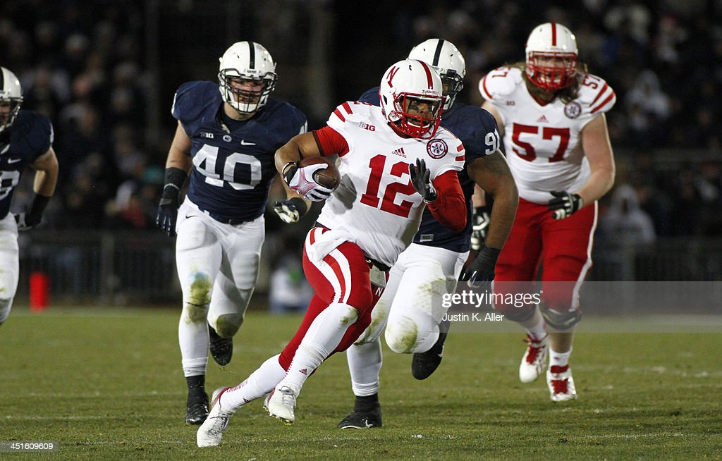 Ron Kellogg III #12 of the Nebraska Cornhuskers rushes against the Penn State Nittany Lions during the game on November 23, 2013 at Beaver Stadium in State College, Pennsylvania.