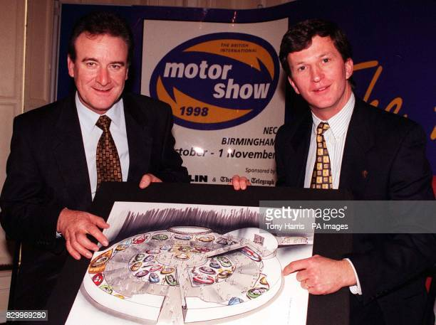 Ron King Head of Public Affairs for The Society of Motor Manufacturers and Philip Jones Motor Show Manager with an artists impression of the the...