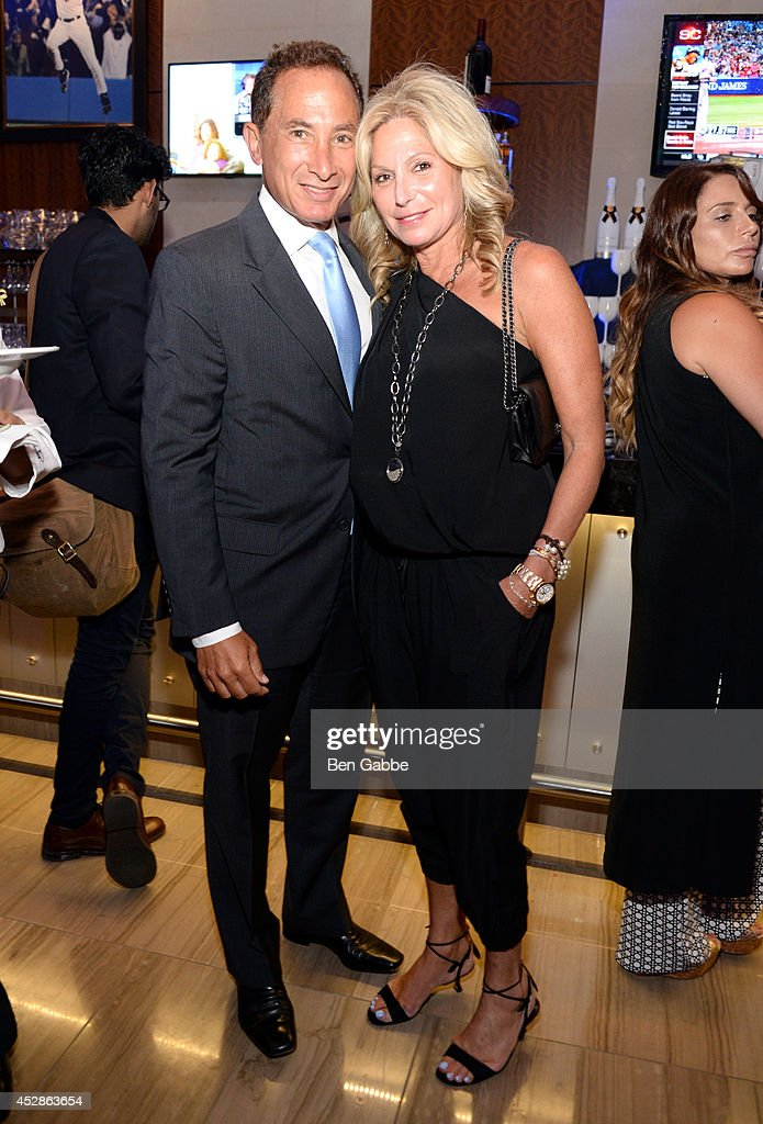 Ron Kramer (L) and Stephanie Kramer attend DuJour Magazine and NYY Steak celebrating Chrissy Teigen with FENDI timepieces and Moet Ice on July 28, 2014 in New York City.