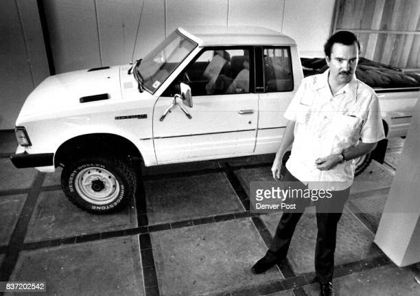Ron Kramer the head OS Consulate official in Mazatlan stands next to the white Datsun truck which belonged to Nicholas Schrock Trvck is Now located...