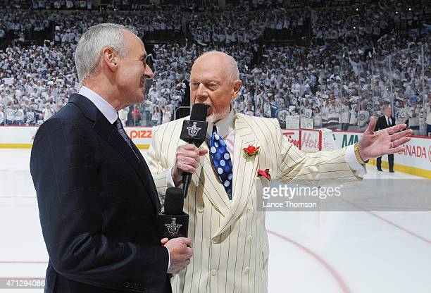 Ron MacLean and Don Cherry of Rogers Sportsnet stand on the ice prior to the faceoff between the Winnipeg Jets and the Anaheim Ducks for Game Three...