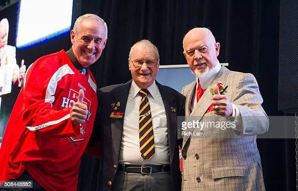 Ron MacLean and Don Cherry pose for a photo with Canadian Veteran Alex Sim at a luncheon during Day 1 of 2016 Scotiabank Hockey Day in Canada on...