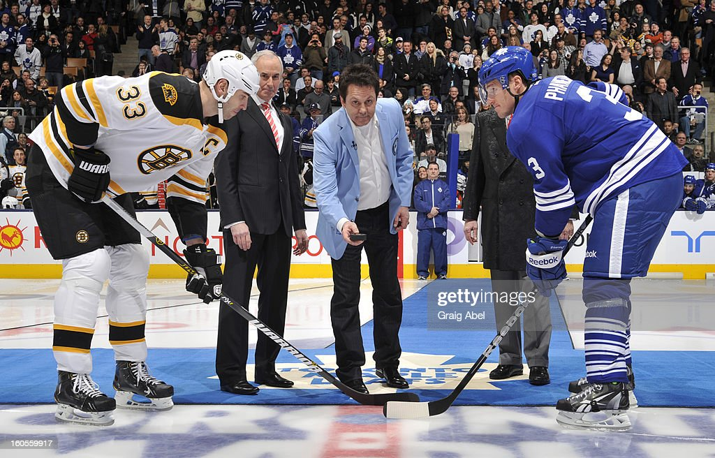 Ron Maclean, Doug Gilmour and Don Cherry take part in an on ice ceremony Zdeno Chara #33 of the Boston Bruins and Dion Phaneuf #3 of the Toronto Maple Leafs during NHL game action February 2, 2013 at the Air Canada Centre in Toronto, Ontario, Canada.