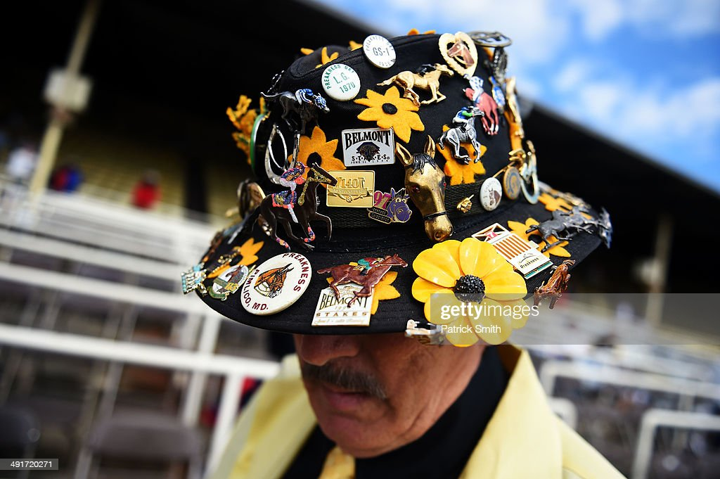 Ron Martin of Tabernacle New Jersey wears a decorative hat prior to the 139th running of the Preakness Stakes at Pimlico Race Course on May 17 2014...