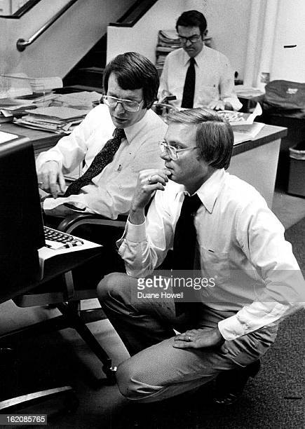 MAY 9 1980 MAY 17 1980 MAY 18 1980 Ron Mitchell kneeling Watches Editor Editing story by computer is Chuck Green Post executive city editor
