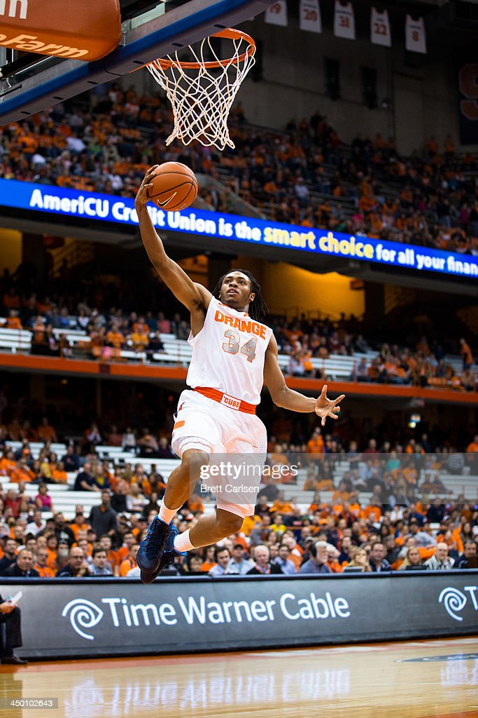 Ron Patterson #34 of Syracuse Orange lays in the final two points of the basketball game against Colgate Raiders on November 16, 2013 at the Carrier Dome in Syracuse, New York. Syracuse defeated Colgate 69-50.