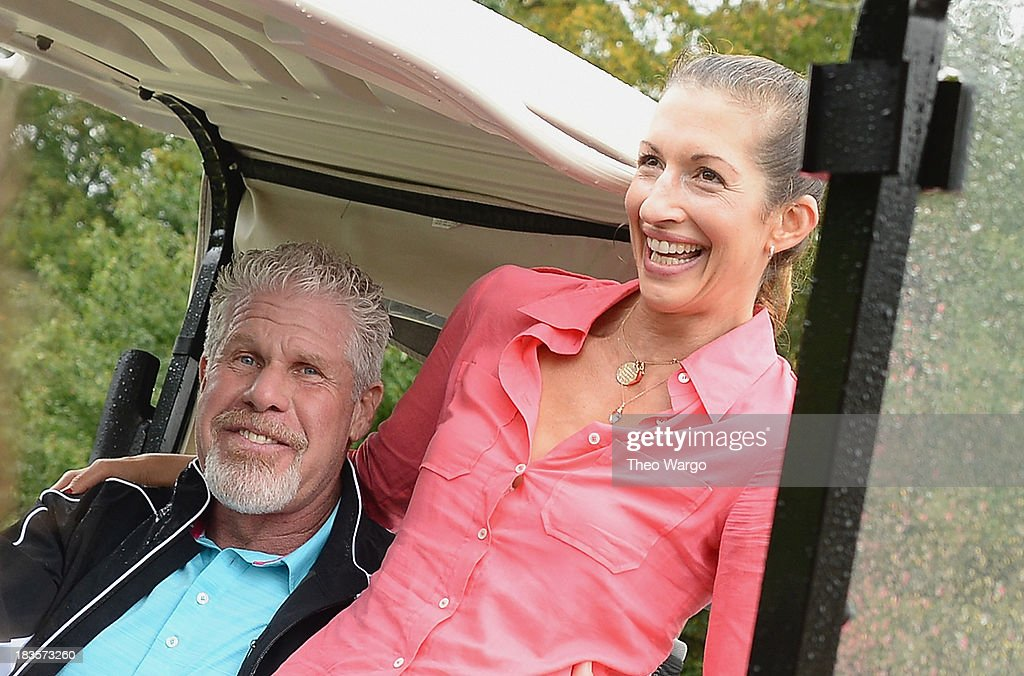 <a gi-track='captionPersonalityLinkClicked' href=/galleries/search?phrase=Ron+Perlman+-+Actor&family=editorial&specificpeople=208159 ng-click='$event.stopPropagation()'>Ron Perlman</a> and <a gi-track='captionPersonalityLinkClicked' href=/galleries/search?phrase=Alysia+Reiner&family=editorial&specificpeople=655685 ng-click='$event.stopPropagation()'>Alysia Reiner</a> attend the Screen Actors Guild Foundation Inaugural New York Golf Classic at Trump National Golf Club Westchester on October 7, 2013 in Briarcliff Manor, New York.