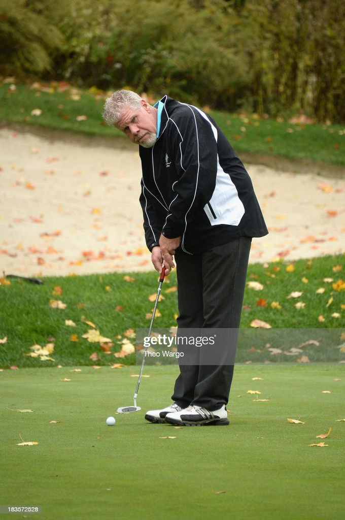 <a gi-track='captionPersonalityLinkClicked' href=/galleries/search?phrase=Ron+Perlman+-+Actor&family=editorial&specificpeople=208159 ng-click='$event.stopPropagation()'>Ron Perlman</a> plays a round of golf at the Screen Actors Guild Foundation Inaugural New York Golf Classic at Trump National Golf Club Westchester on October 7, 2013 in Briarcliff Manor, New York.