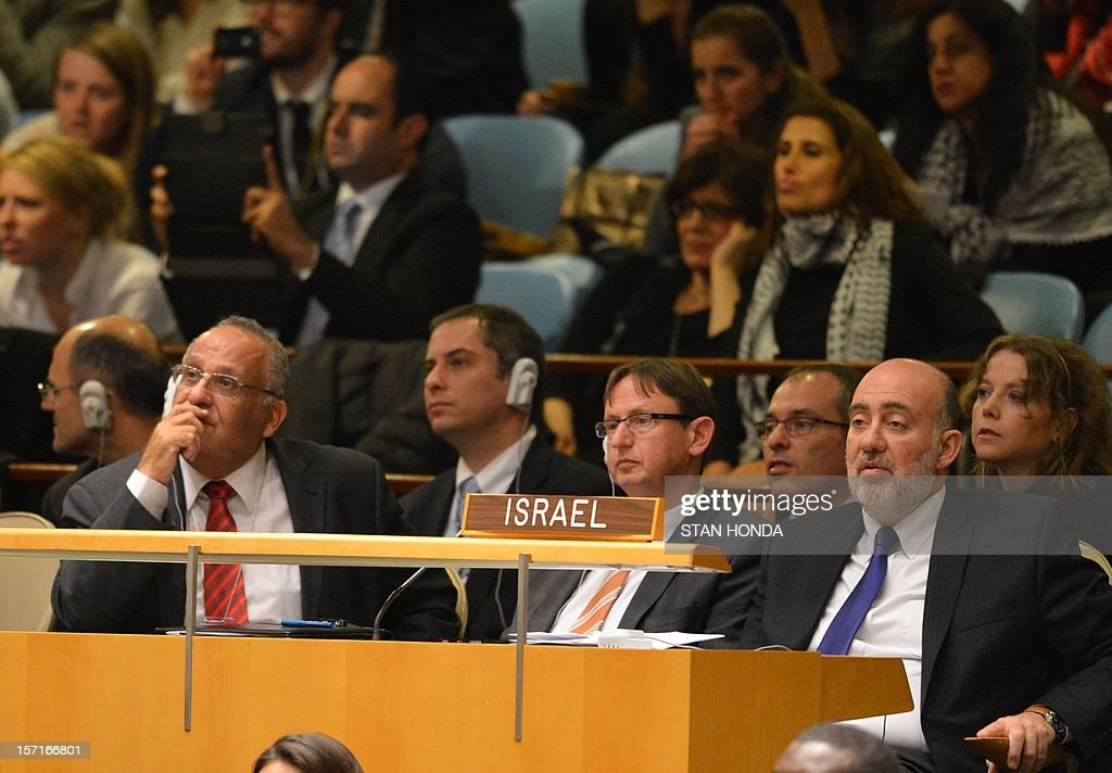 Ron Prosor (R), Israel's Permanent Representative to the United Nations, and his delegation watch the electronic tally board as the United Nations General Assembly votes on a resolution to upgrade the status of the Palestinian Authority to a nonmember observer state November 29, 2012 at UN headquarters in New York. AFP PHOTO/Stan HONDA