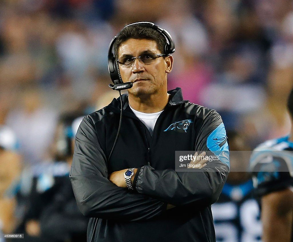 Ron Rivera of the Carolina Panthers watches the action against the New England Patriots in the second quarter at Gillette Stadium on August 22 2014...