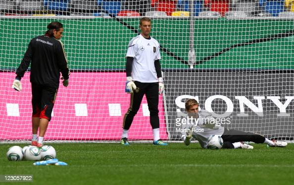 Ron Robert Zieler goalkeeper of Germany saves the ball during the German National Team training session at esprit Arena on August 30 2011 in...