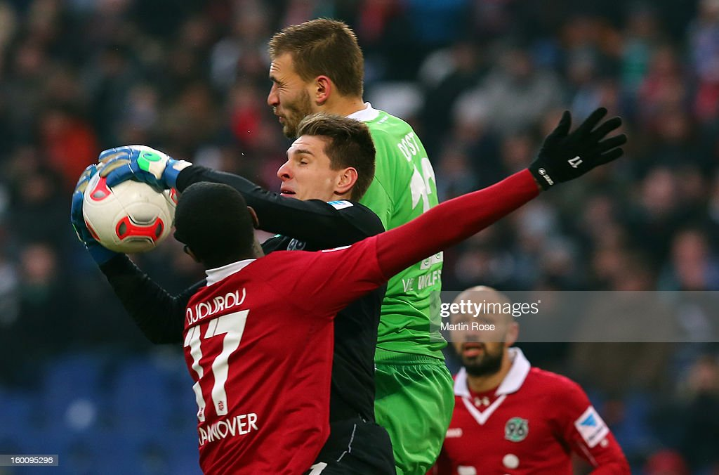 Ron Robert Zieler (C), Goalkeeper of Hannover saves the ball during the Bundesliga match between Hannover 96 and VfL Wolfsburg at AWD Arena on January 26, 2013 in Hannover, Germany.