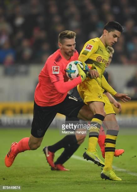 Ron Robert Zieler of Stuttgart is challenged by Marc Bartra of Dortmund during the Bundesliga match between VfB Stuttgart and Borussia Dortmund at...