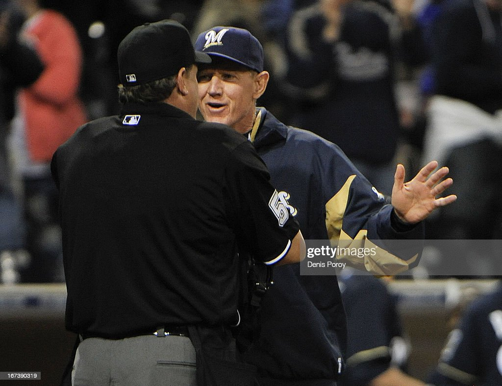 Ron Roenicke #10 manager of the Milwaukee Brewers, right, argues with home plate umpire Paul Emmel after the final out in the ninth inning of a baseball game against the San Diego Padres at Petco Park on April 24, 2013 in San Diego, California. . The Padres won 2-1.