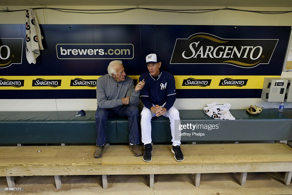 Ron Roenicke #10 of the Milwaukee Brewers is interviewed by Bob Uecker, left, before the game against the Atlanta Braves at Miller Park on April 1, 2014 in Milwaukee, Wisconsin.